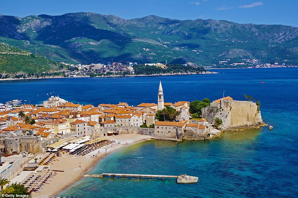 Due to its vaccination programme, Montenegro's foreign minister said it could be 'corona-safe' before the start of the summer season. Pictured is the town of Budva on the Adriatic coast