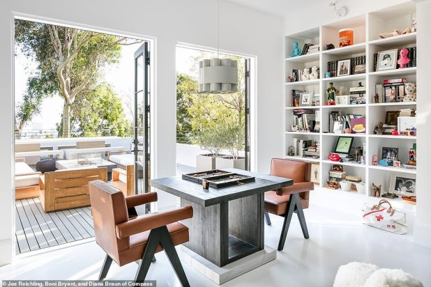 Recently renovated: They had a classic contemporary home transformed by interior designer Mandy Graham, designed to showcase her collection of art and curios.