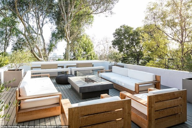 By Fire: Another terrace has a fire pit with plenty of lounge space, where guests can take in picturesque panoramic views.