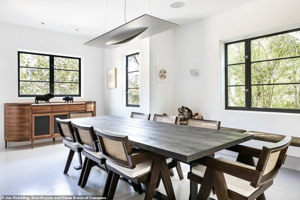 Contemporary flooring: Interior has concrete / epoxy composite flooring on the lower level and oak hardwood floors on the upper level