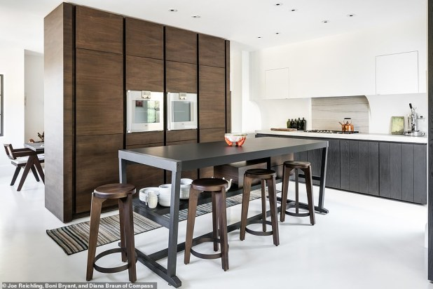 Kitchen Porn: Minimalist Kitchen features a custom ebony-stained oak storage unit and top-of-the-line appliances with countertops made of Macaubus granite and Phenix NTM.