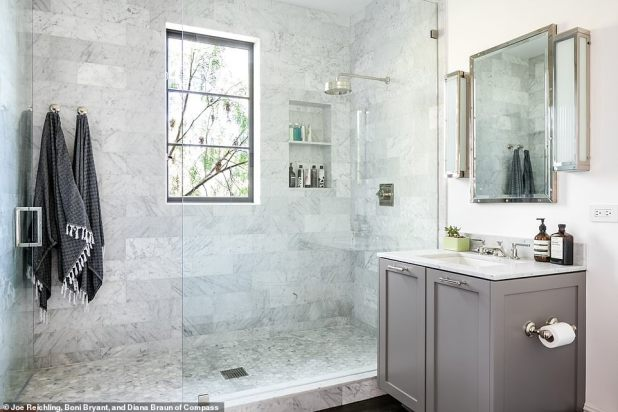 Luxurious Shower: It also has a large glass-enclosed, marble tiled shower