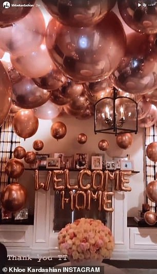 Warm welcome: Her Hidden Hills home was elevated with rose gold balloons and roses, which made her smile after the holiday