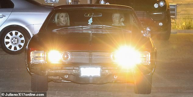 Making an entrance: The duo rolled up to the celebrity haunt in Carter's bright red Buick
