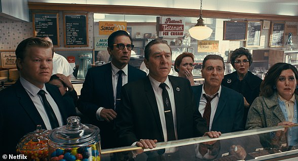 A clip from The Irishman film in a break in the trial of Jimmy Hoffa, from left, Chuckie O'Brien (Jesse Plemons), Bill Bufalino (Ray Romano), Frank Sheeran (Robert De Niro) and Hoffa (Al Pacino) appear shocked at the news of JFK's assassination