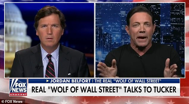 Speaking to Tucker Carlson, left, on Fox News, Belfort explained how the stock shot up as a volunteer army of investors challenged big institutional hedge funds