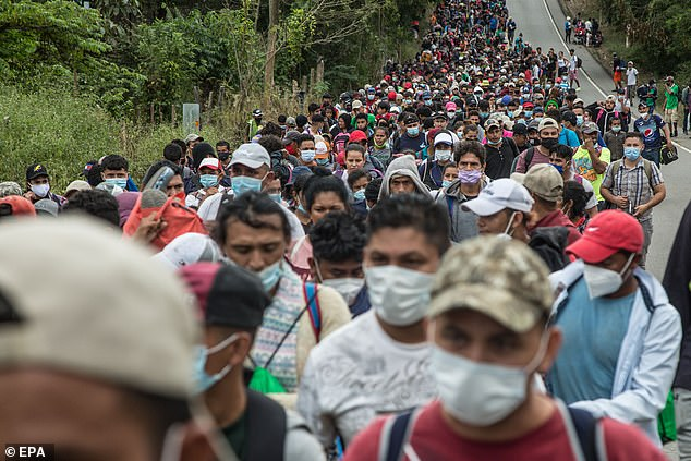 Bidenwill call for his administration to streamline the naturalization of nine million migrants. Pictured: Honduran migrants head to the US through Guatemala