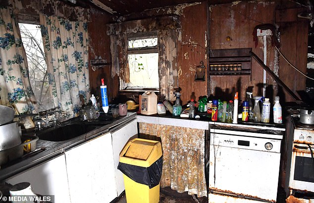 The kitchen - a good size space if renovated - is littered with pots and pans, jars of food on the worktop, the kettle is still plugged in and the past owner's 'best' china remains displayed on a Welsh dresser