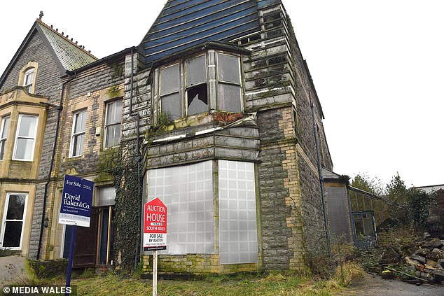 An abandoned house on one of Wales' poshest streets is going under the hammer for £325,000 - despite having holes in the roof, a pigeon infestation and rotting windows