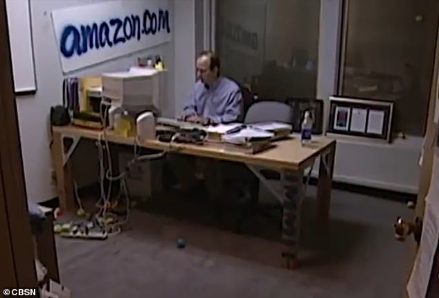 A 1999 60 Minutes interview shows Bezos in an office with a spray-painted amazon.com sign