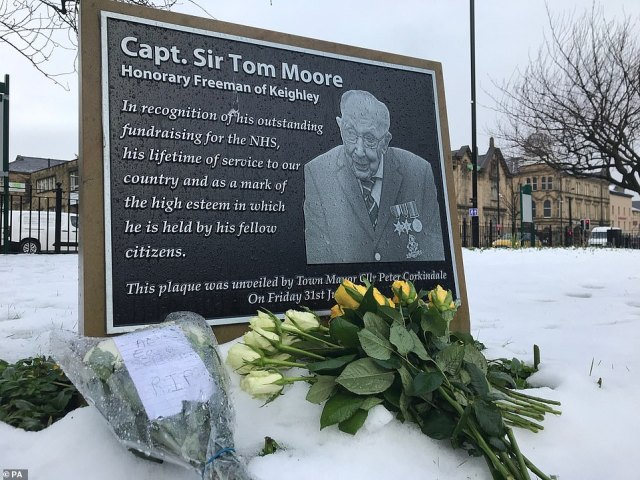 Tributes today at the plaque at the Town Hall Square in Keighley, Yorkshire, where Captain Tom was born and grew up
