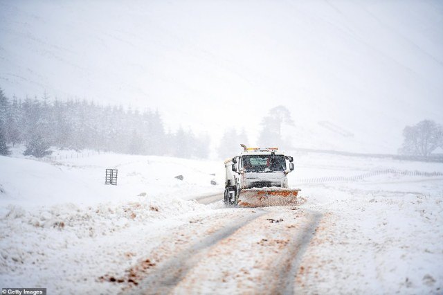 A snowplough clears the A708 at Cappercleuch in the Scottish Borders today with more blizzards on the way