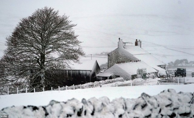 Snow covers the hills and properties in the County Durham village of Harwood today with more blizzards on the way