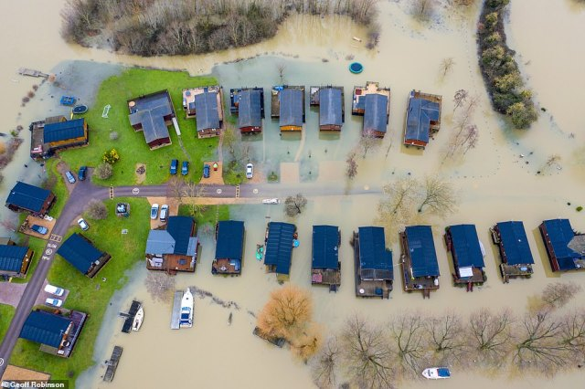 Mobile homes surrounded by floodwater near Huntingdon in Cambridgeshire today after the River Great Ouse burst its banks