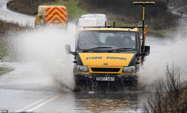A lorry travels through a flooded road at Seaton Delaval in Northumberland this afternoon
