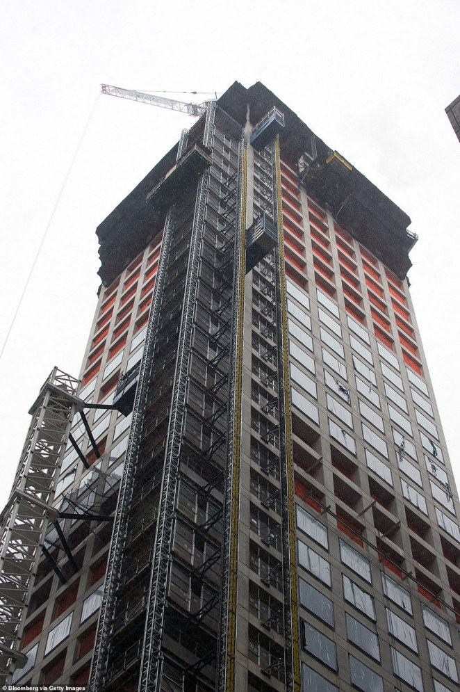 The building is seen above during its construction phase in December 2013. At the time its construction was completed, it was the tallest residential skyscraper in the world