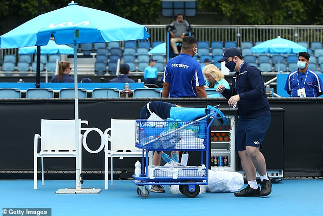 600 Australian Open staff, players and officials have now been forced to isolate (pictured, cleaners at Melbourne Park on January 31)