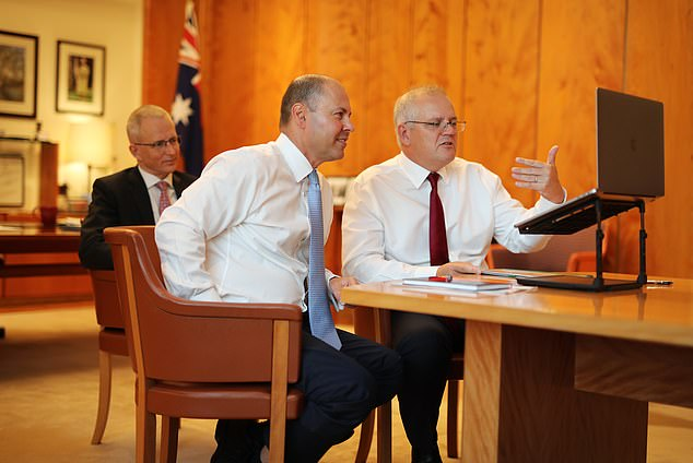 Australian ministers (Prime Minister Scott Morrison, right, Treasurer Josh Frydenberg, left, and Communication Minister Paul Fletcher, rear) have agreed to make four concessions to the law which will make it more beneficial to Facebook