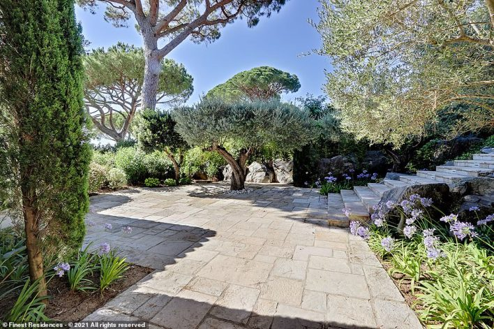 Les Parcs de Saint-Tropez also boasts a private beach andsecure access, which is controlled by 'elite security personnel'. Pictured are the villa's well-maintained grounds