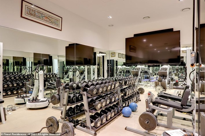 According to the list, residents will 'enjoy sport training in a large, professionally equipped fitness room', pictured
