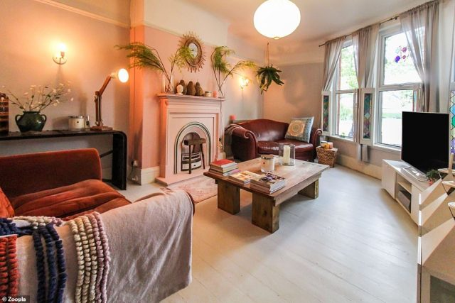 The colourful interior of the four-bed property includes a separate living room with a pastel pink fireplace