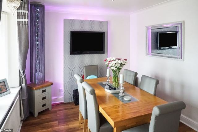 Various shades of grey and pink: The lighting scheme and mirror theme continues in the dining room