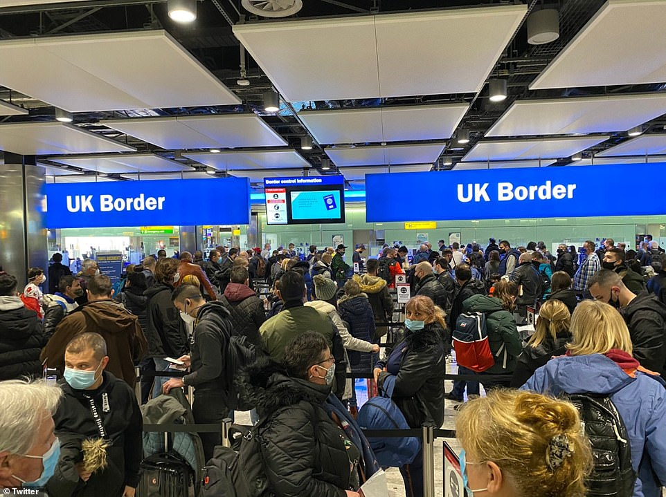 Crowds of arrivals pack into a queue at Heathrow Airport as thousands continue to come into the UK from abroad each day