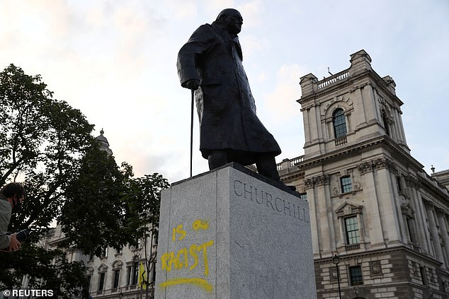 Pictured: Graffiti is seen on the statue of Winston Churchill, in London, in September last year
