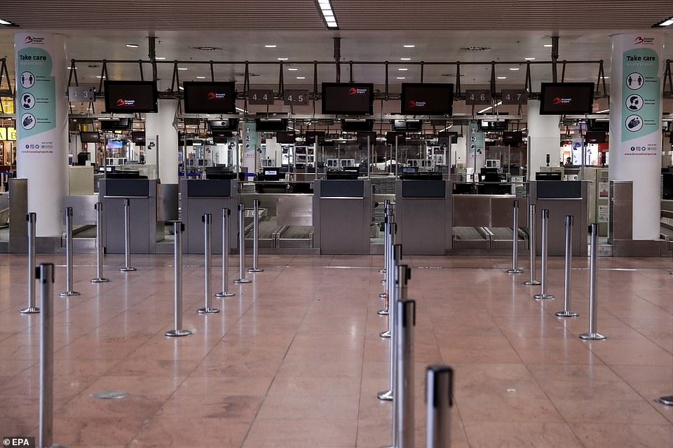 BELGIUM: An empty check-in area at Brussels Airport is pictured last Wednesday as planes remain grounded across the world