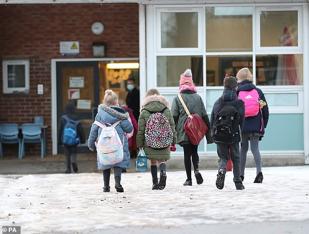 Young pupils arrive at Manor Park School and Nursery in Knutsford, Cheshire, last month