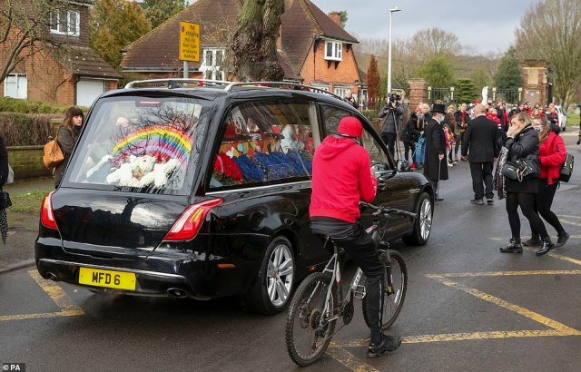 The brightly covered coffin, adorned with pictures of sweets, was accompanied by floral bouquets resembling a rainbow, a burger and a cola can, while another arrangement carried the message: 'Love you bro'