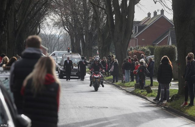 The funeral procession of Olly Stephens slows at All Hallows Road, Reading to receive floral tributes, before making its way to Reading Crematorium