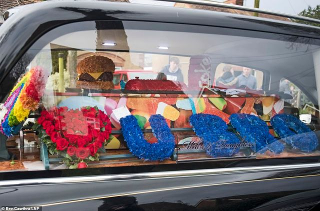 Flowers and Haribo sweets in the hearse as the funeral procession carrying the coffin of teenager Olly Stephens arrives at Reading Crematorium