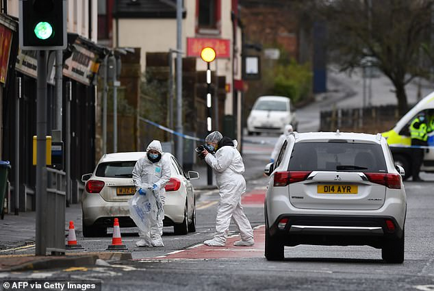 Police forensics officers at the scene of a fatal stabbing in Portland Street, Kilmarnock, in west Scotland