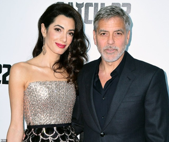 Amal Clooney (left) and George Clooney (right) at the Catch-22 UK premiere at Vue Cinema Westfield in London in May 2019