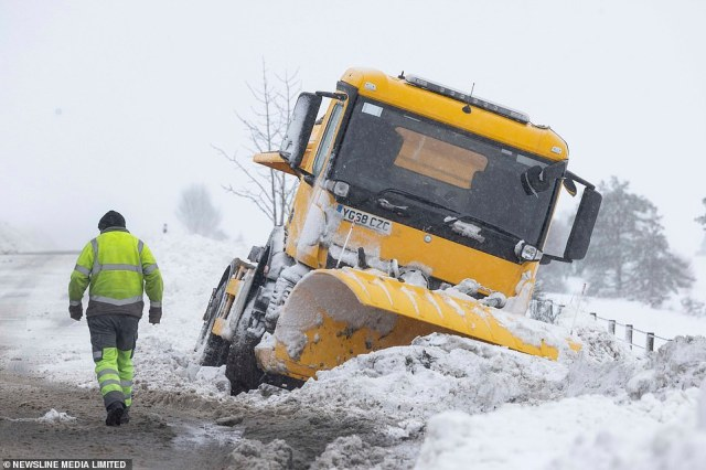 A snowplough is awaiting recovery today after coming off the A920 Huntly to Dufftown Road in the Highlands in the snow