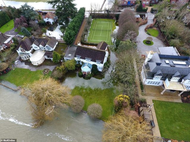 The flooding danger for Gervais seemed less severe and a tennis court in the rear garden did not appear to be under threat.