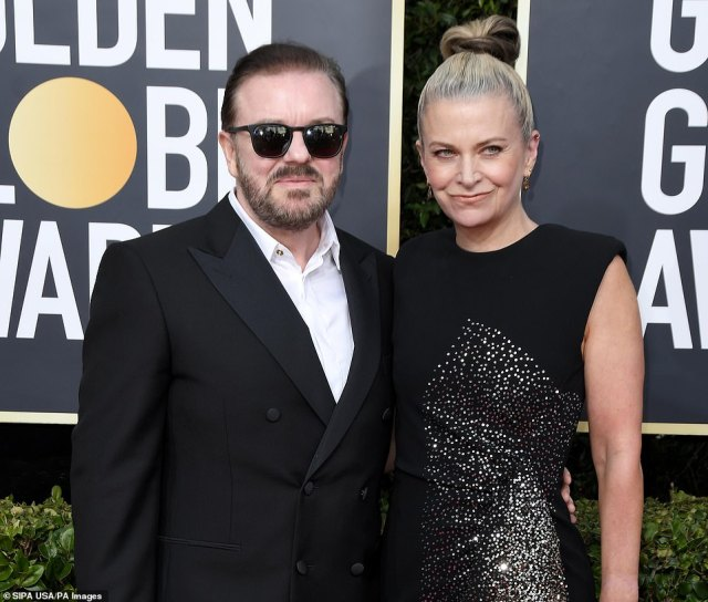 Ricky Gervais and his partner Jane Fallon arrives at the Golden Globe Awards in Beverly Hills, California, in January 2020