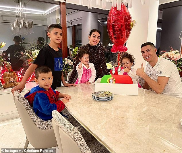 Cute: Recently, Ronaldo took to Instagram to post a snap of his family enjoying a Portugal-themed cake on his 36th birthday, as he also marked his 20th year as a professional football star