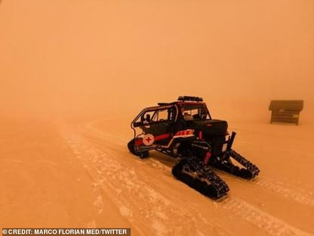 A ski truck was also seen ploughing through a cloud of orange in Sestriere, Italy's western Alps, near the French border, which was described as a 'Martian landscape'