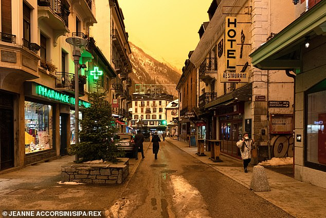A orange hue was seen over the streets of theChamonix Mont-Blanc Valley today