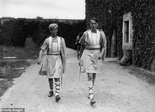 Prince Philip (left) in costume for a production of 'Macbeth' at his school Gordonstoun in Scotland in July 1935