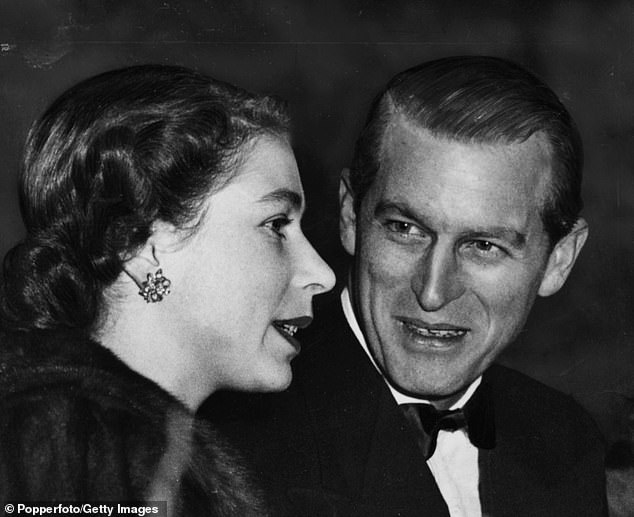 Elizabeth and Philip talking in the Royal Boxat Olympia in London in 1952, the year before she was crowned
