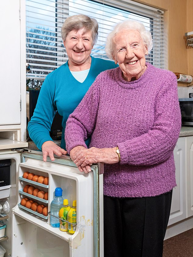 Harold Macmillan was in Downing Street when Susan Loftus¿s (pictured left with her 94-year-old mother, Brenda) father Frank brought his Prescold Packaway fridge in 1960