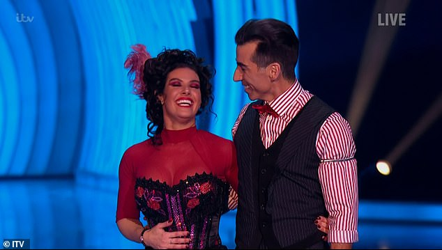 Busty! Rebekah flaunted her ample cleavage in the red and black cancan costume