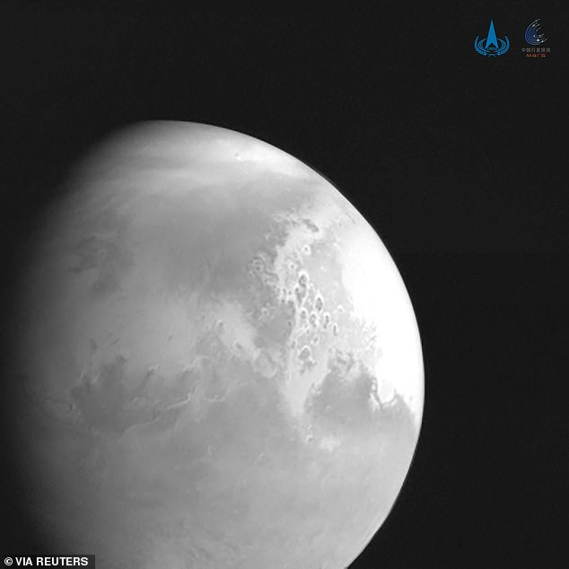 The stunning black and white image was taken when Tianwen-1 was 1.4million miles (2.2million km) from the martian surface and although it fails to capture the trademark rusty appearance of the world, it captures the world's unique terrain