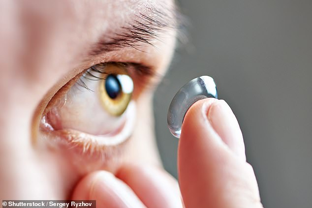 Alongside improving your vision, a new smart contact lens design could monitor for conditions including diabetes, heart disease and stroke, a study has reported (stock image)