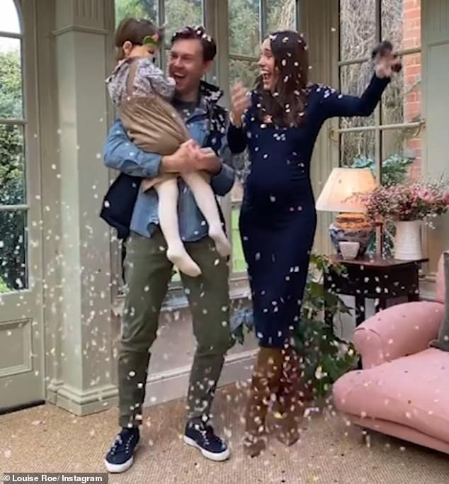 'You've got a sister!':Louise took to the social media platform to share footage of herself, Mackenzie, and their daughter Honor, three, bursting a balloon filled with pink confetti