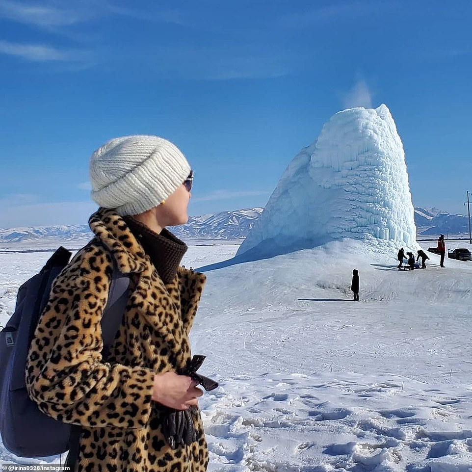 Kazakhstan's Almaty region is covered in a thick blanket of snow and ice, but the harsh weather has not stopped thousands of people from visiting the area's 'ice volcano'