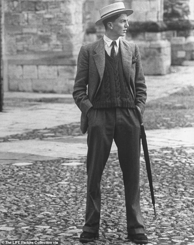 A young man carrying a perfectly rolled umbrella at the prestigious school in 1951